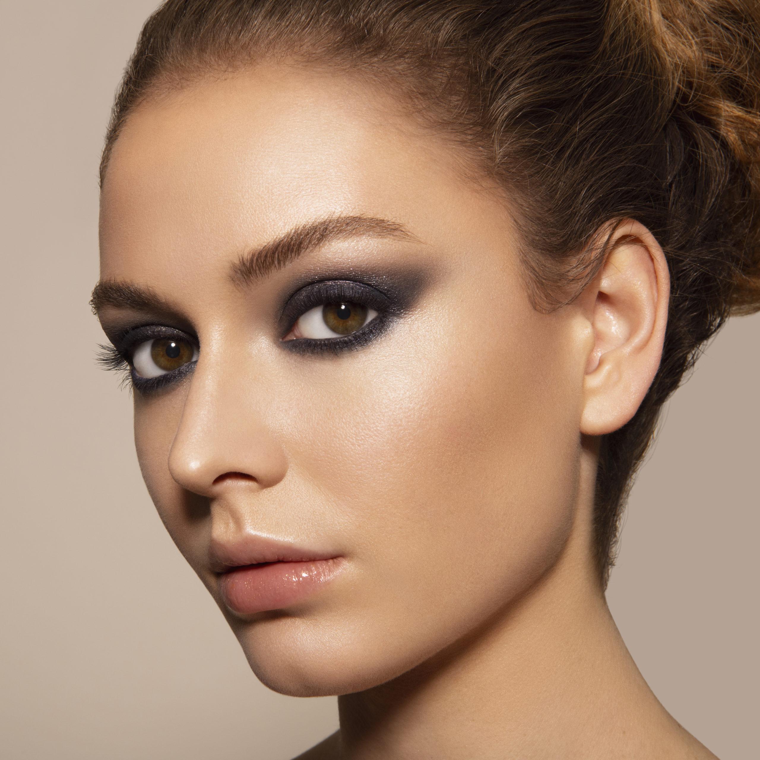 Model wearing classic blue smokey eye look