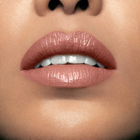 Model wearing Mii Moisturising Lip Lover Reminisce Lipstick